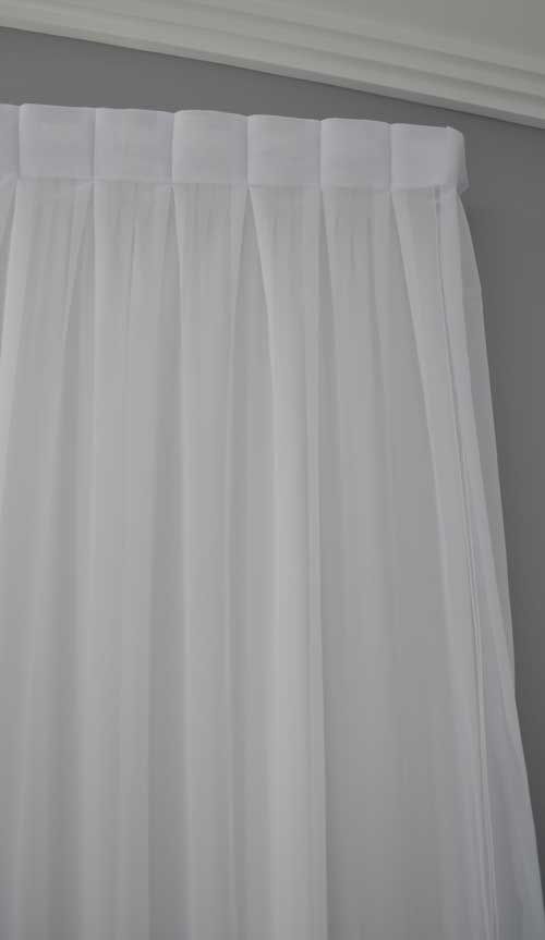 thick white curtain with creases