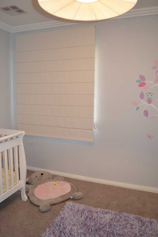 infant room with white blinds
