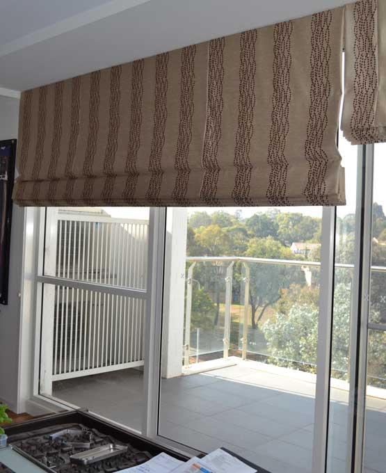 lined blinds near sliding glass door