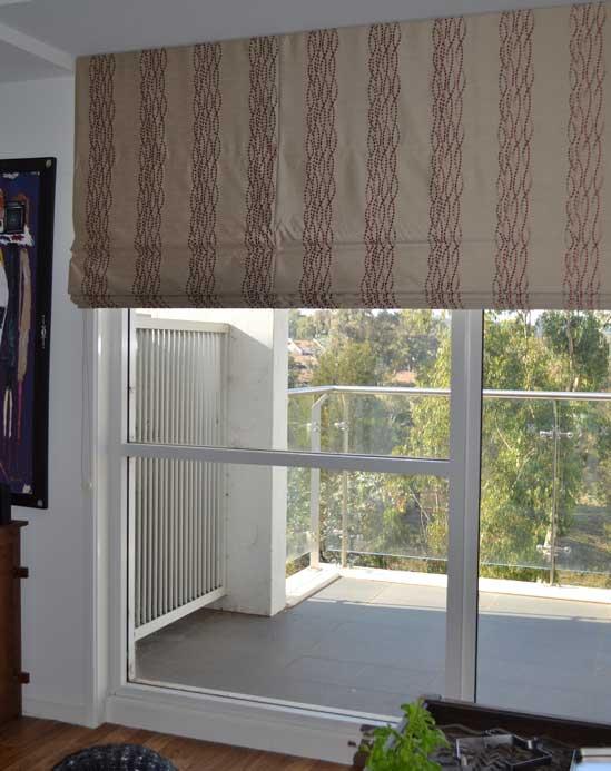 lined blinds near balcony