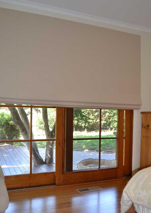 white blinds on wooden windows