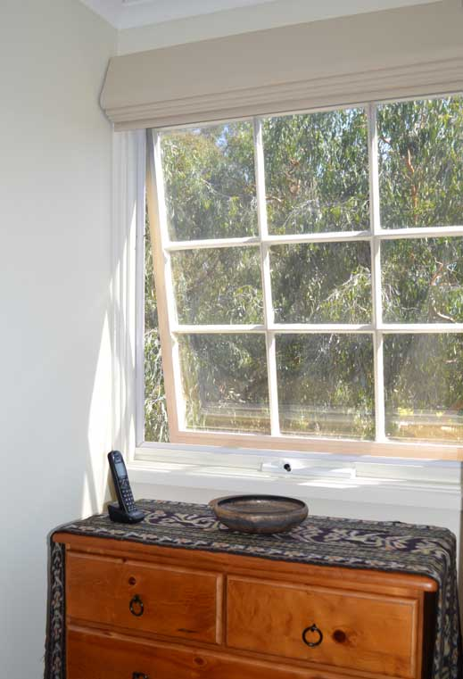 open window near dresser