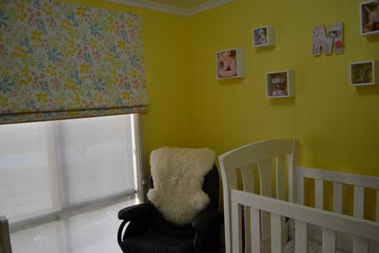 baby room with yellow walls
