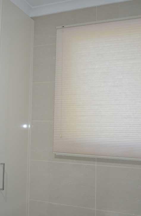 white blinds in bathroom