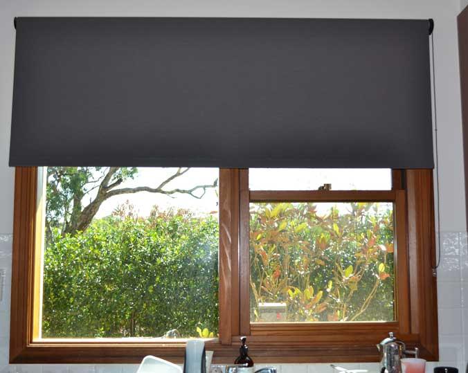 grey blinds on wood window