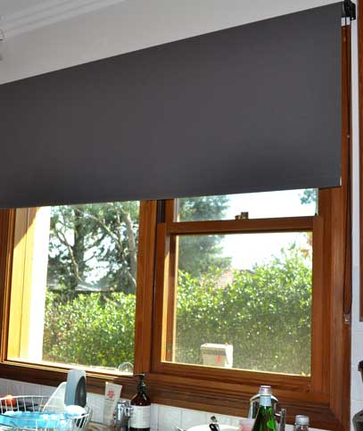 wood window with grey blinds