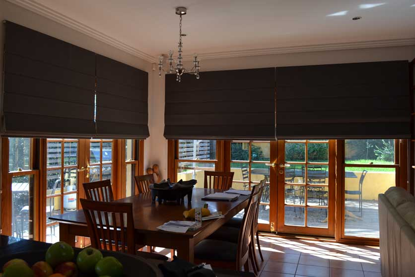 dark colored table near windows