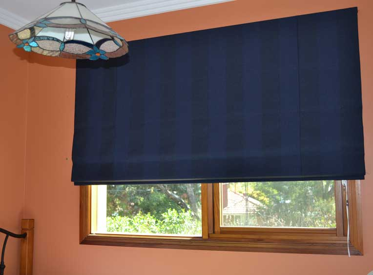 blue blinds on orange wall