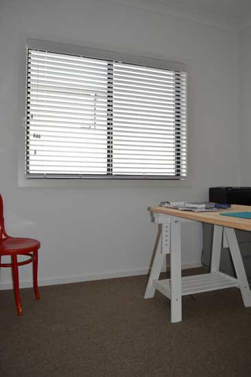 white wall window with open blinds on window