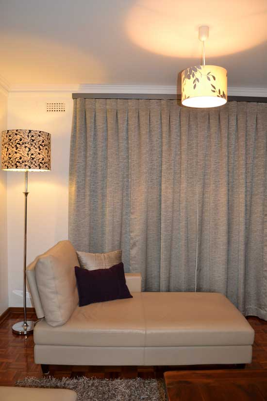 simple grey curtains with nice couch