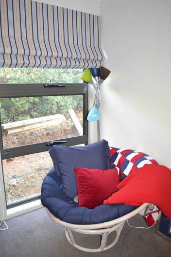 large window with folded up stripped blinds