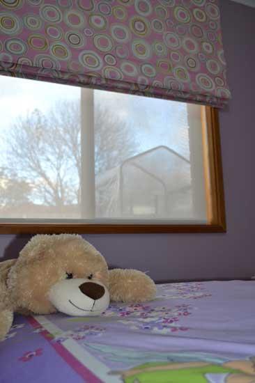 stuffed bear on purple bed