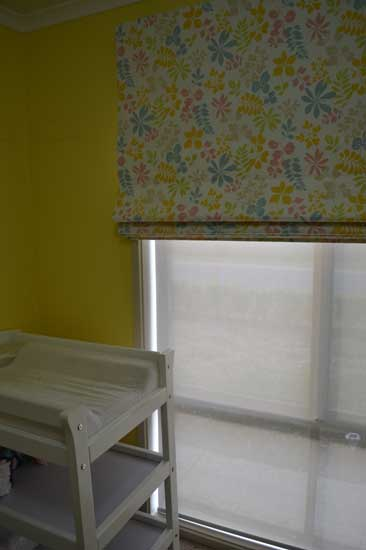 child changing room with floral colorful curtains