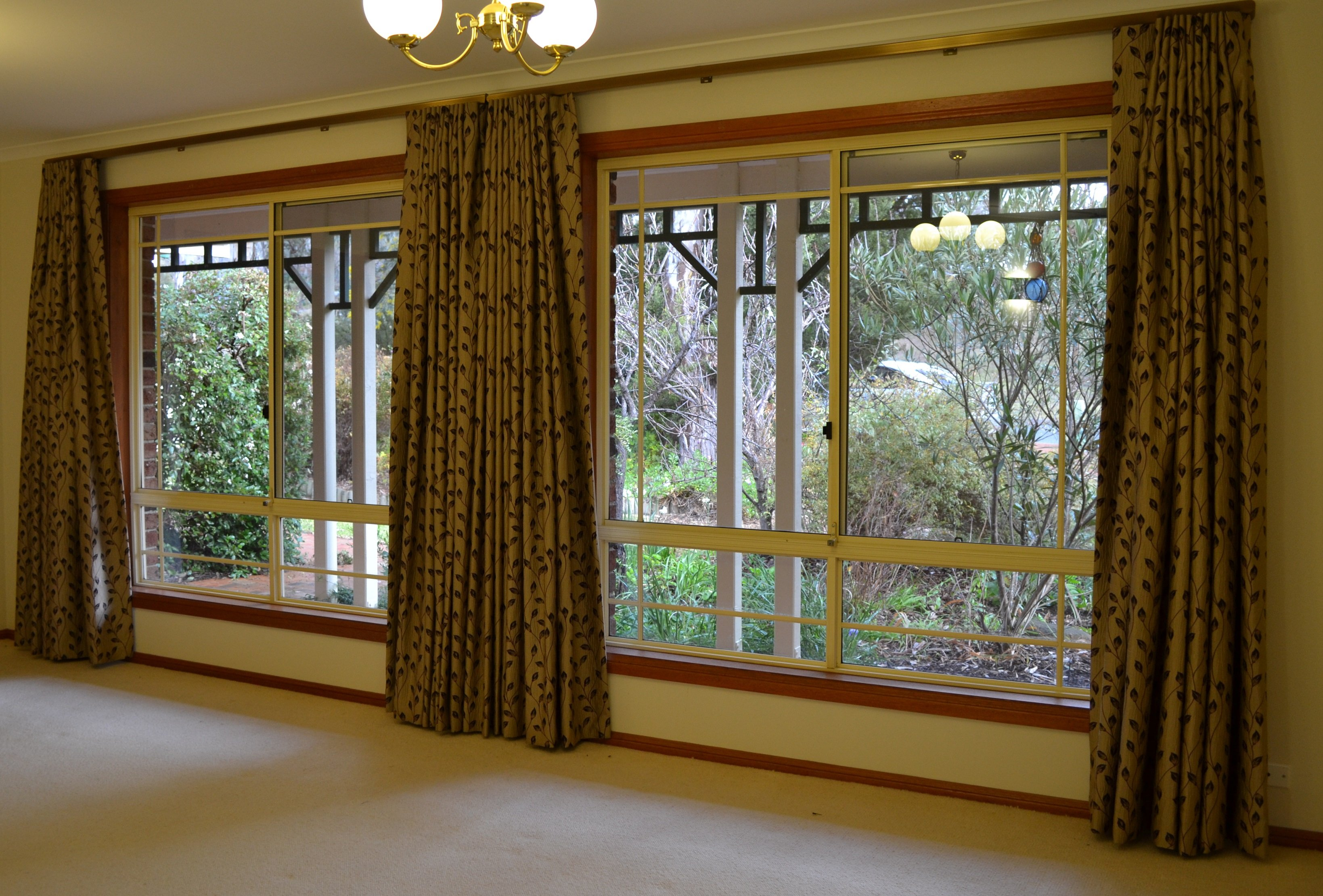 two sets of large window curtains