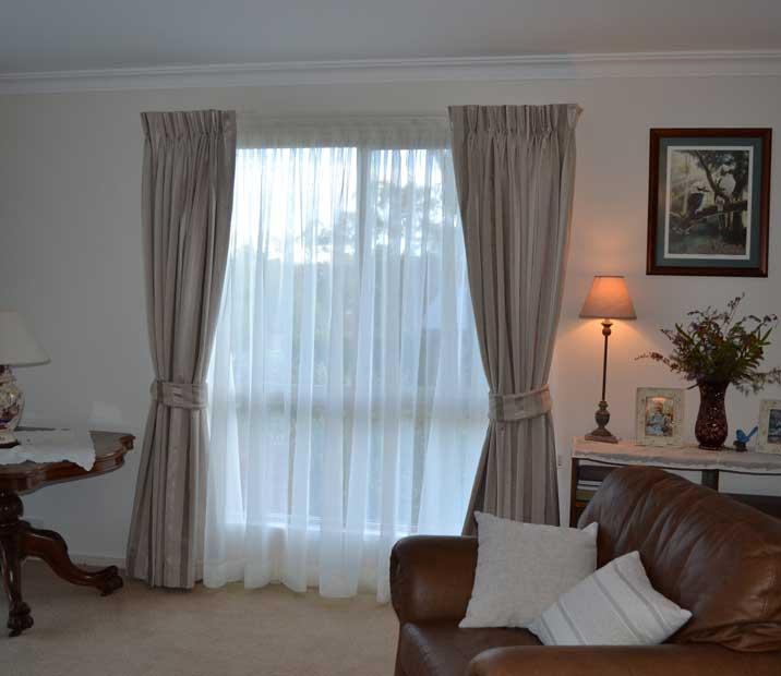 neutral curtains tied apart