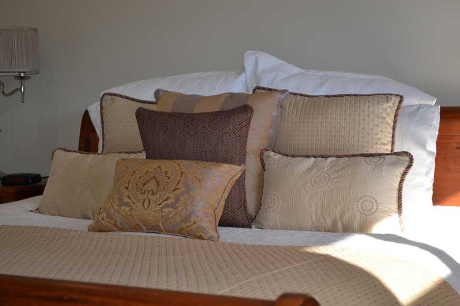 variety of golden throw pillows