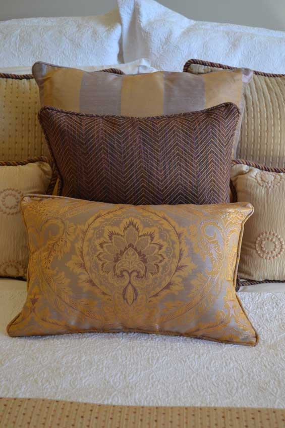golden pillows on bed two