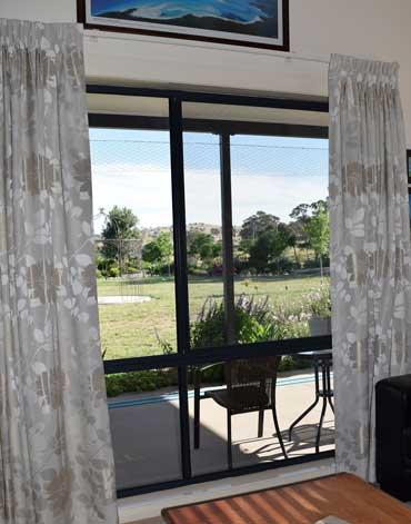 neutral bedroom shades overlooking yard