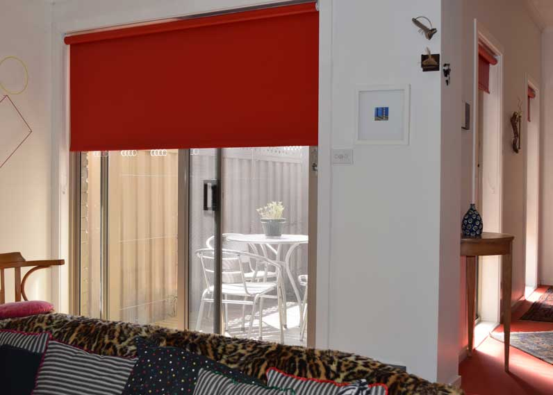 bright red shades over sliding doors