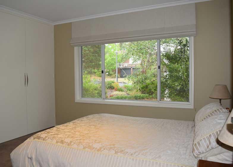 bedroom shades overlook greenery