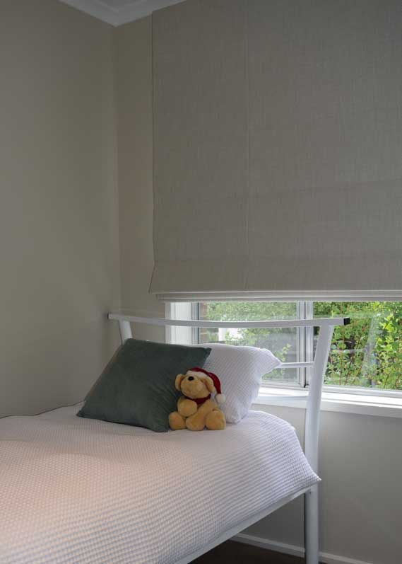 plain white shades in bedroom