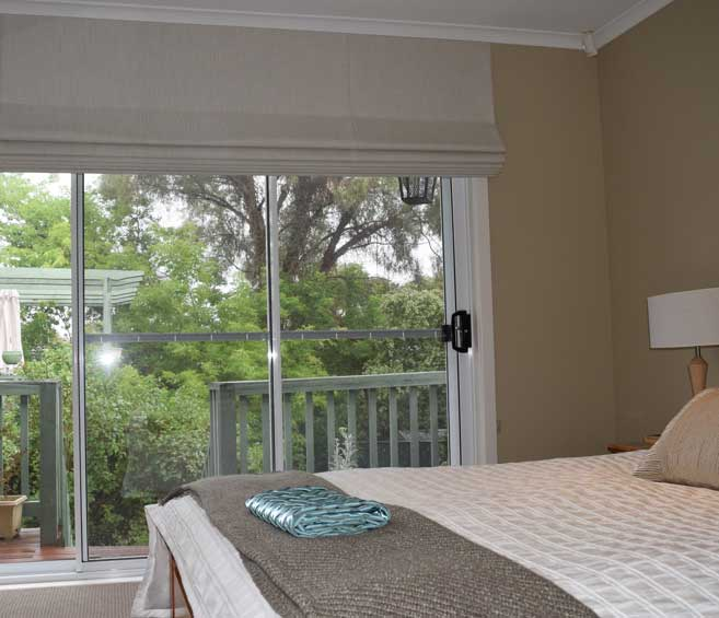 white shades in master bedroom