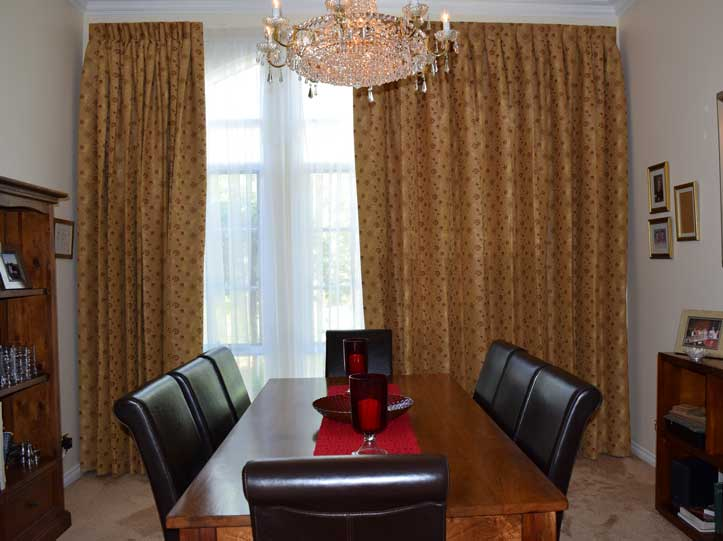gold curtains with chandelier