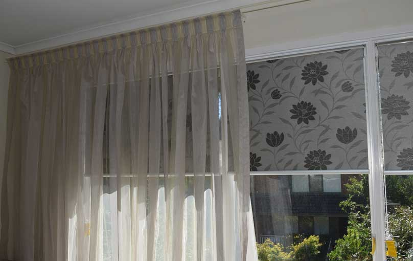 sheer curtains over patterned blinds