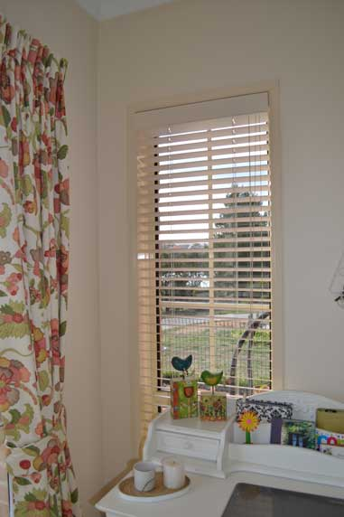 floral curtains and cream blinds