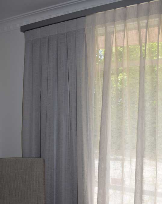white sheer curtains on window