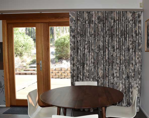 patterned curtains in dining room