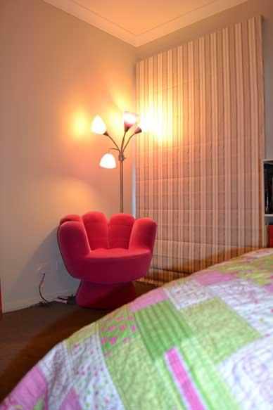 lamp near pink chair