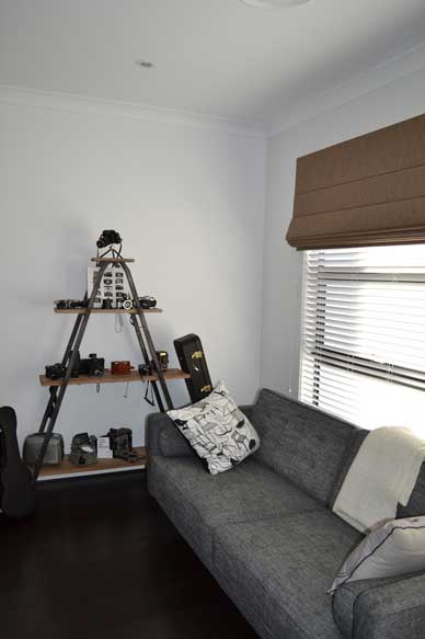 pyramid shelf with grey couch