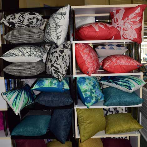 shelf of colourful pillows