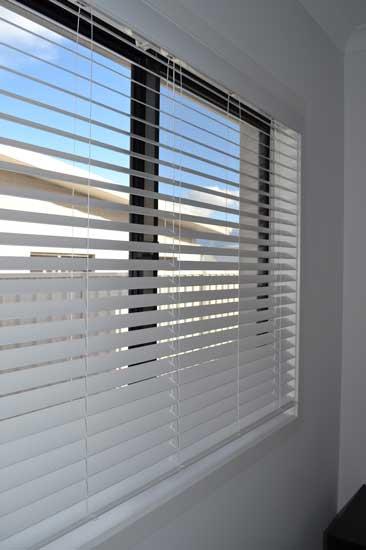 white blinds on large window