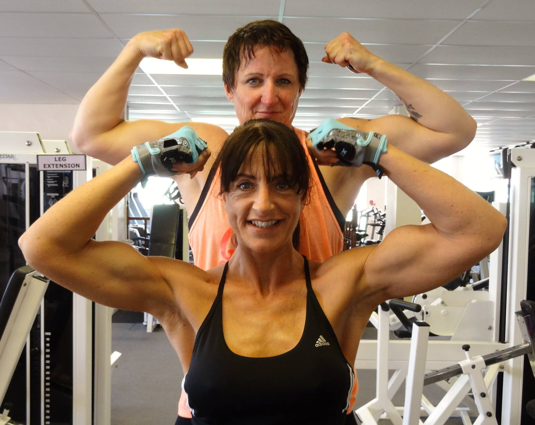 a lady showing her bicep muscle