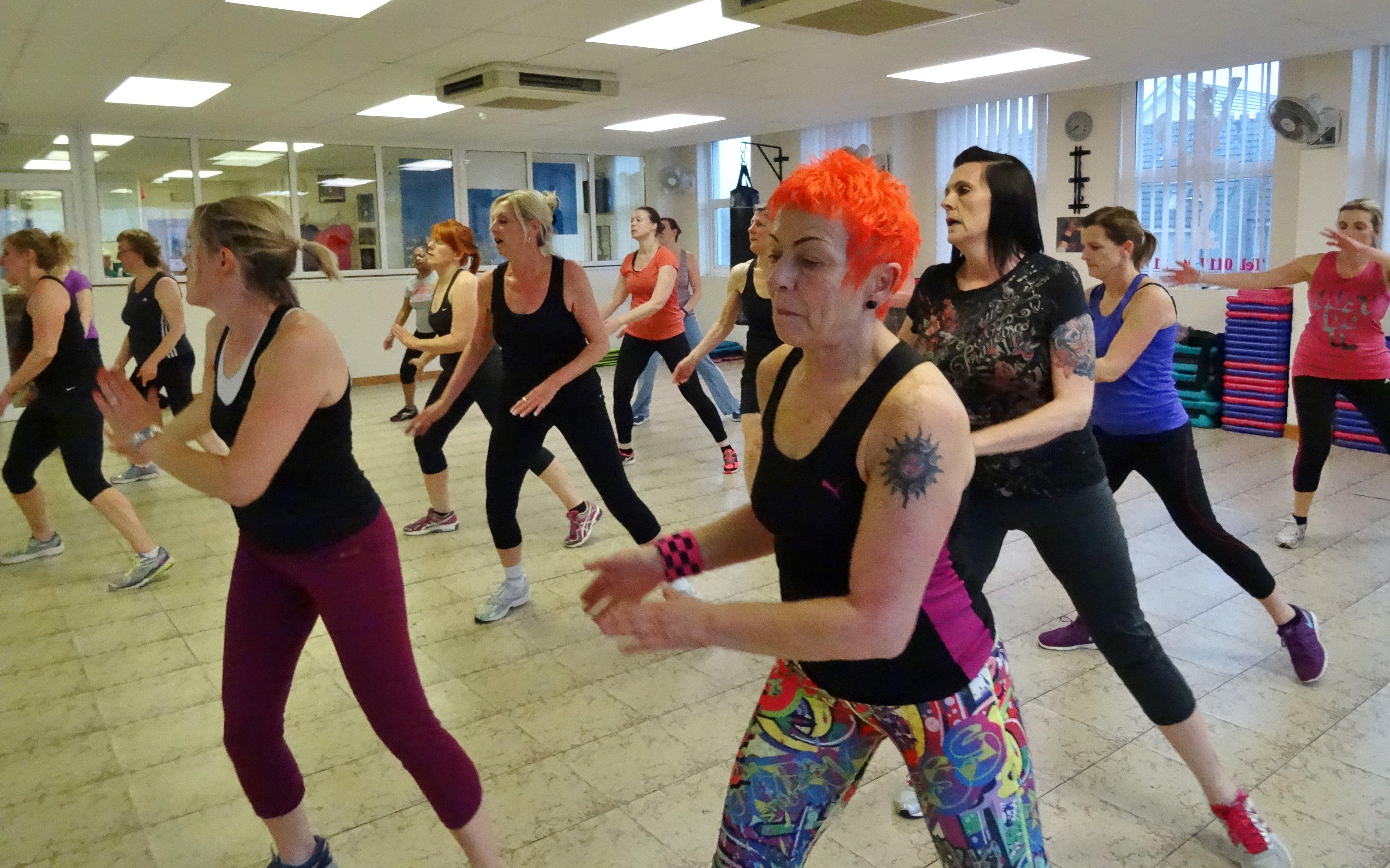 ladies practicing aerobics