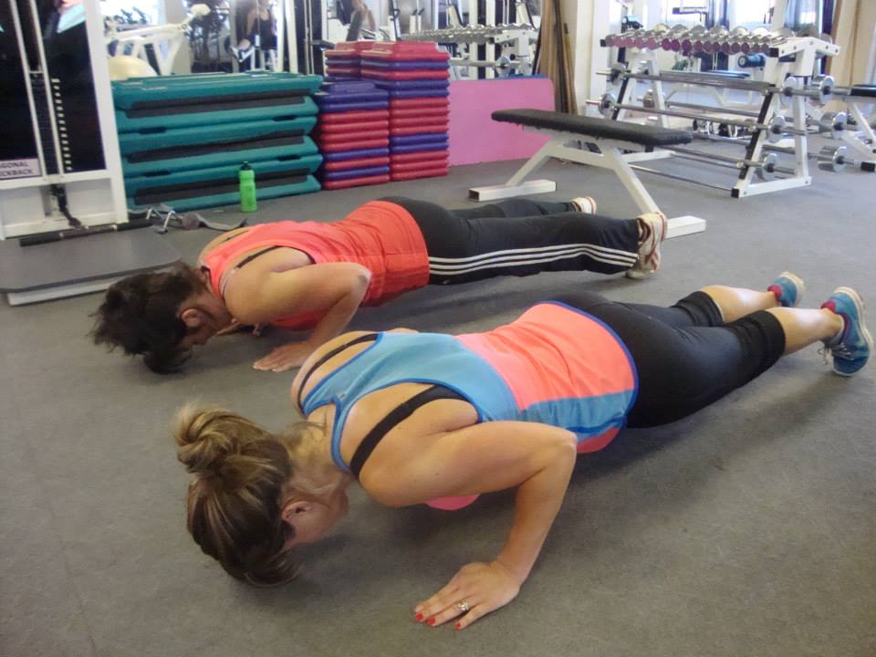 2 ladies working out on the floor