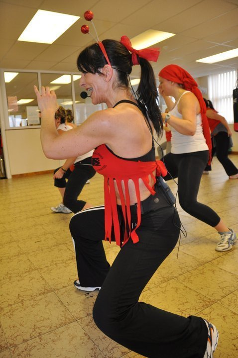 fitness trainer showing the exercises