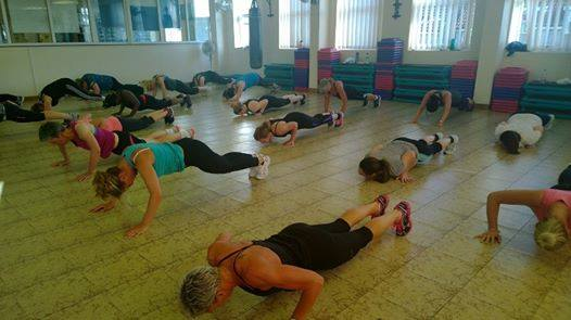several ladies involved in floor exercise
