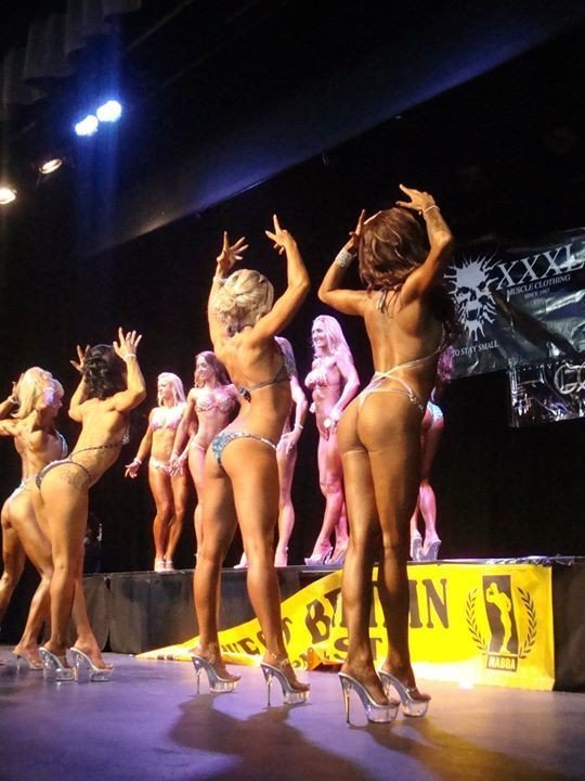 a bunch of bodybuilders at an event