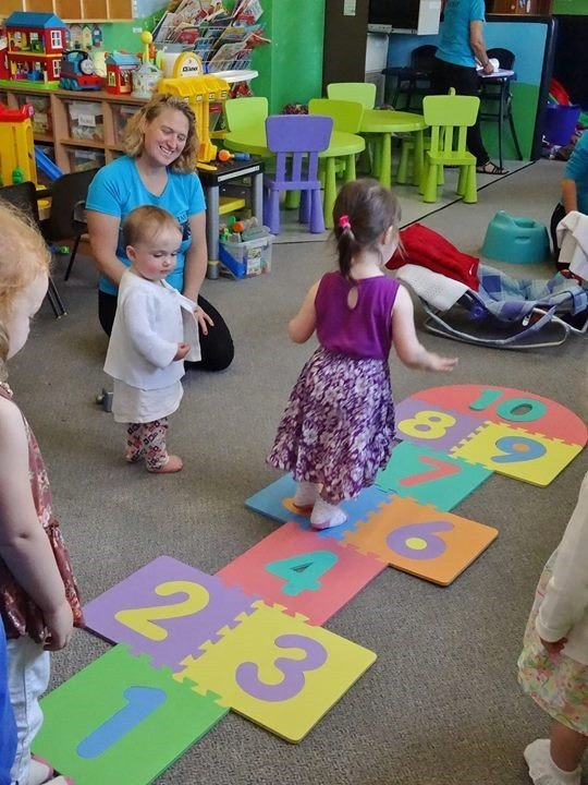 several kids playing at the creche