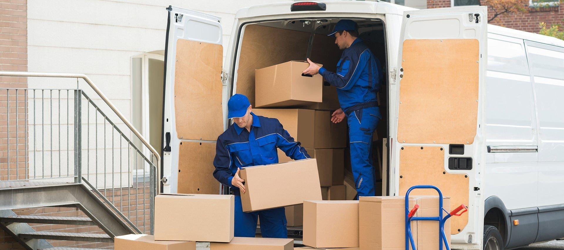 men loading boxes in a van