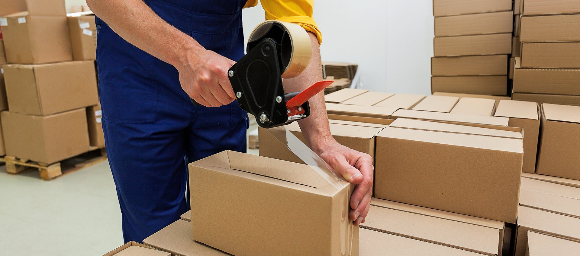 man sealing box