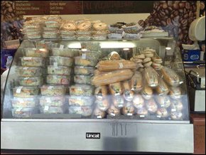 Display cabinet filled with baguettes and salads
