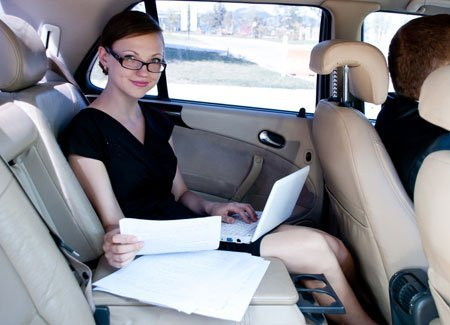 A lady sitting in a taxi