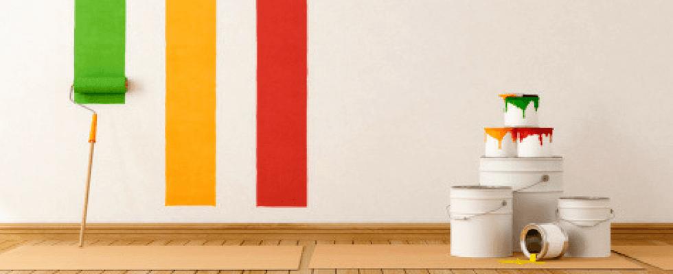 barattoli di vernice e rullo per pittura
