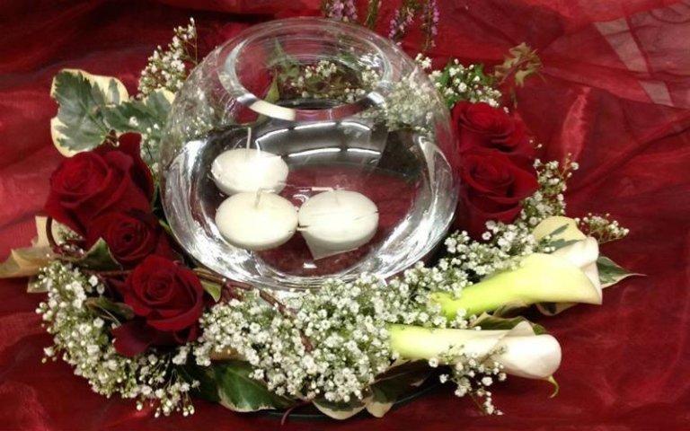 Composizioni con candele e vasi