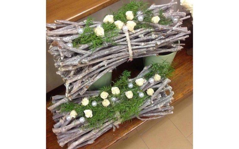 Composizioni floreali con rami