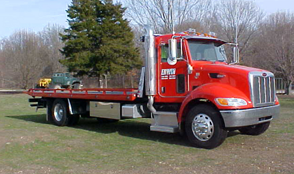 A red towing truck from Jim Erwin Wrecker Service